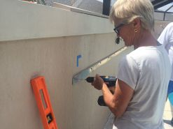 Cathy installs the aluminum cleat